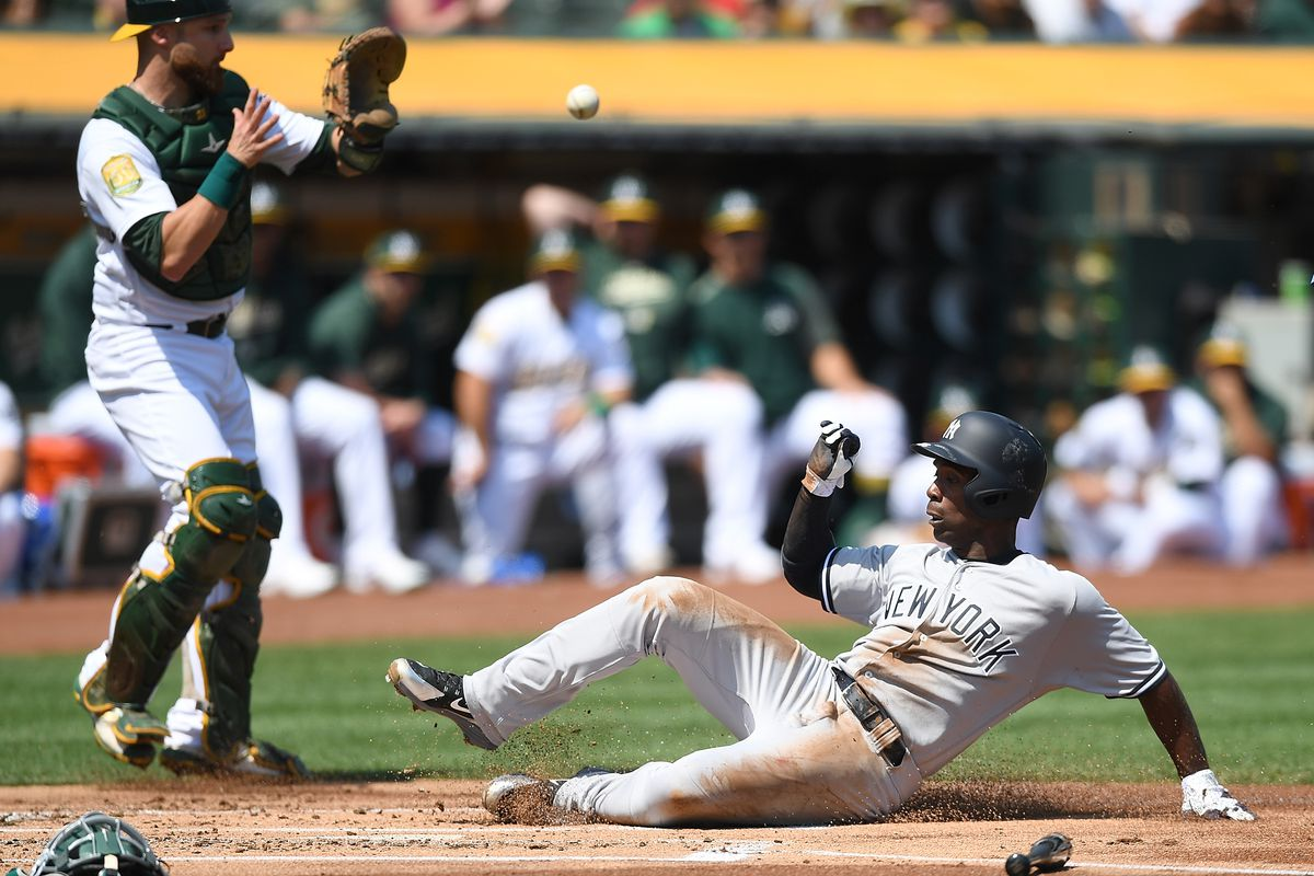 Andrew McCutchen manufactures a run against the Athletics in the top of the first inning at Oakland Coliseum on Labor Day.