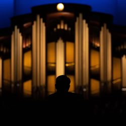 An attendee is shadowed against the Conference Center organ during the Saturday evening session of the 191st Semiannual General Conference of The Church of Jesus Christ of Latter-day Saints at the Conference Center in Salt Lake City on Saturday, Oct. 2, 2021.
