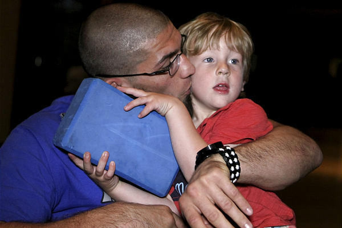 """Court McGee kisses his 3-year-old son, Isaac, after the """"The Ultimate Fighter Party"""" at The Academy Wednesday."""