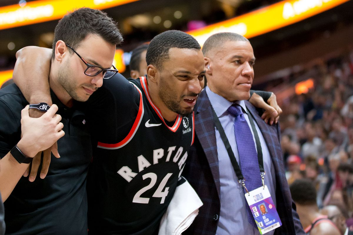 Toronto Raptors guard Norman Powell is helped off the court after being injured during the first quarter against the Utah Jazz at Vivint Smart Home Arena.