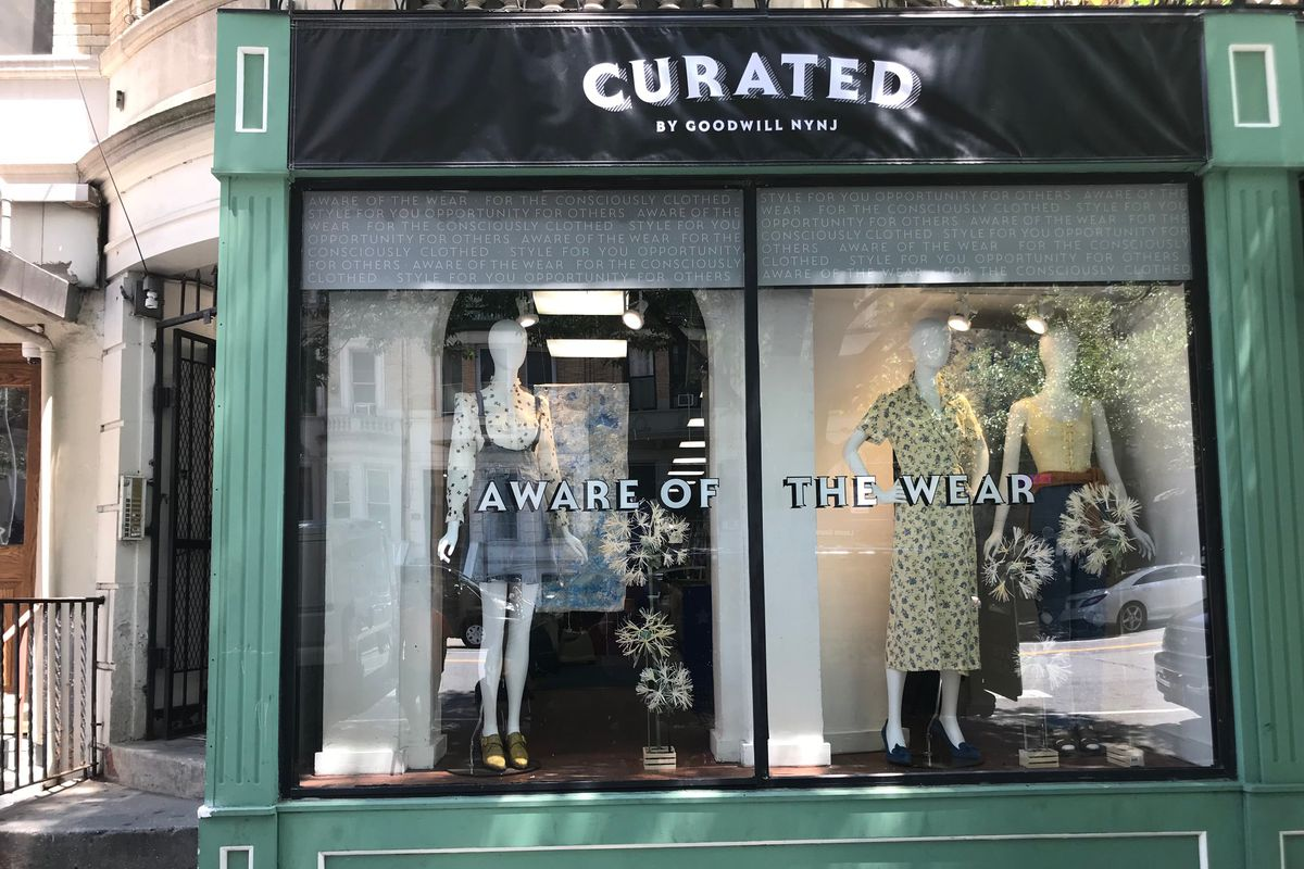 A view of the storefront with mannequins in the window.