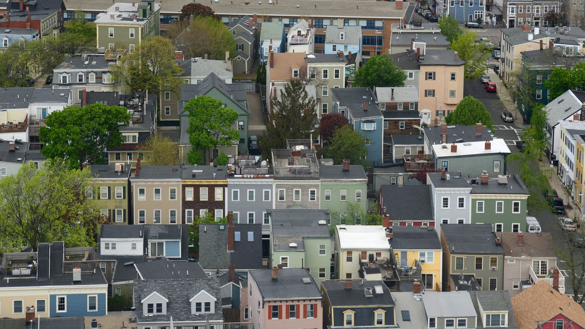 Aerial view of rows of small apartment buildings.