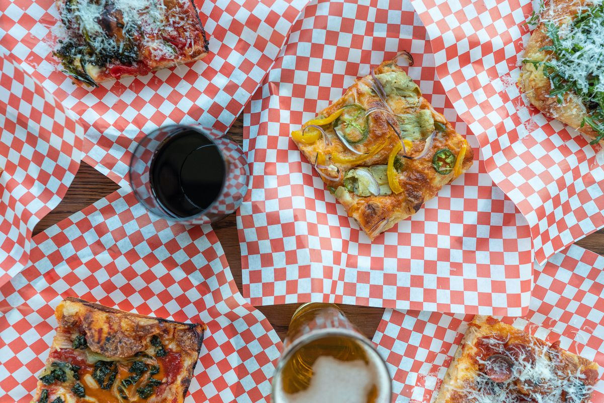Venice Way Pizza with red checkered paper