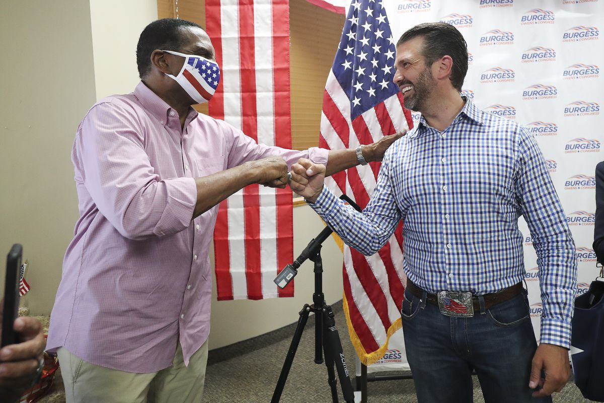 Donald Trump Jr., right, meets with congressional candidate Burgess Owens and volunteers at Colonial Flag in Sandy on Thursday, July 23, 2020.