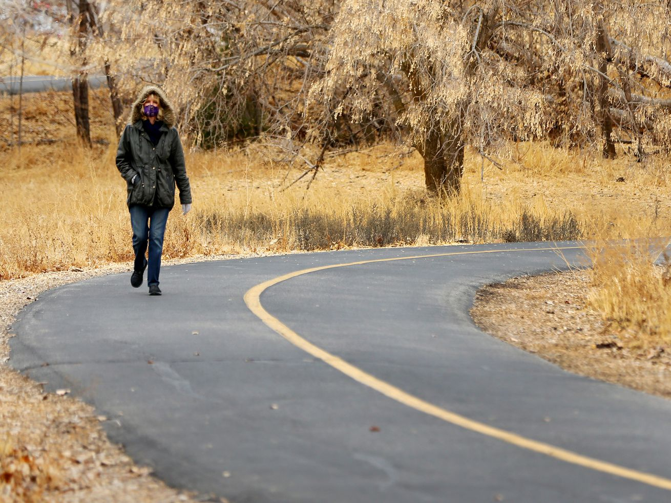 Marilyn Smith goes for a walk on the Murray Parkway on Friday, Nov. 13, 2020.