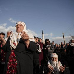 In this Wednesday March 28, 2012 photo Bulgarian Muslim women pray during commemoration ceremony for the victims of the communist repression,  39 years ago, in Breznitsa, some 10 km from the village of Kornitsa, Bulgaria. On March 28, 1973 police and army units stormed the village of Kornitsa and opened fire on hundreds at people gathered in the square to protest the communist regime's campaign to force Bulgaria's Muslims to adopt non-Islamic names and break up their communities. The brutal crackdown left five men dead and more than 100 wounded. More than 70 families were forced to leave their homes and settle in remote villages.