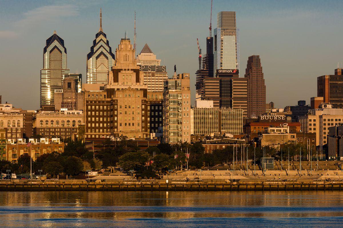 The skyscrapers of Philadelphia rise above the Delaware River at sunrise