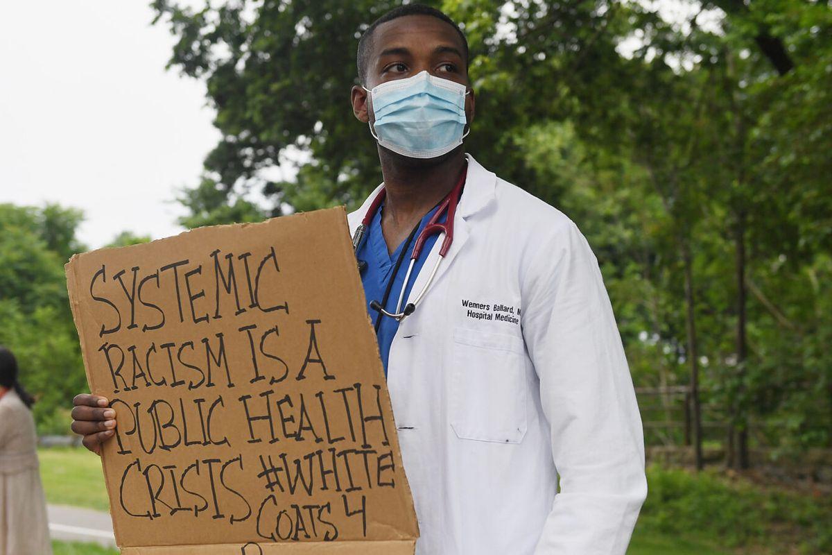racism as public health crisis sign