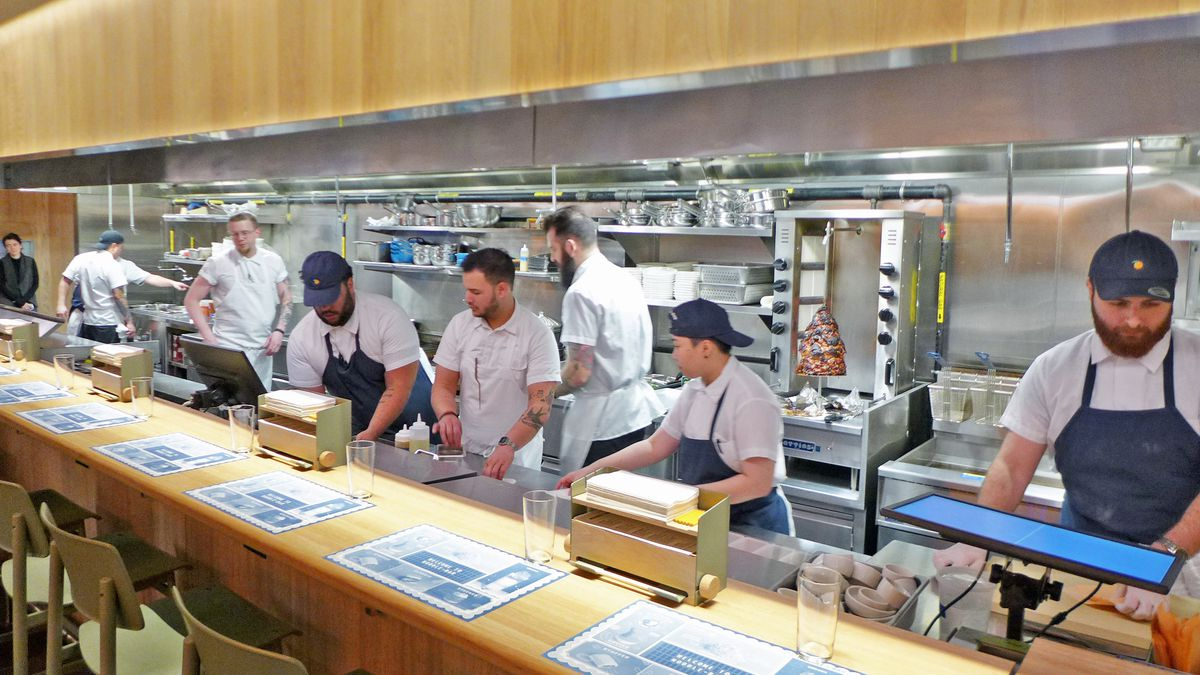 Sit in the midst of the kitchen staff as you eat at the new Momofuku Noodle Bar.