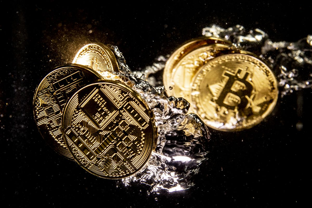 A picture of gold coins with a B dollar sign on them to represent bitcoin.