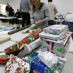 Leslie Hutchen of Sandy wraps presents at the 13th annual Giving Tree program at Valley Fair Mall in West Valley City on Tuesday, Dec. 15, 2015. The program provides Christmas presents to 170 children from 61 low-income families in the city.