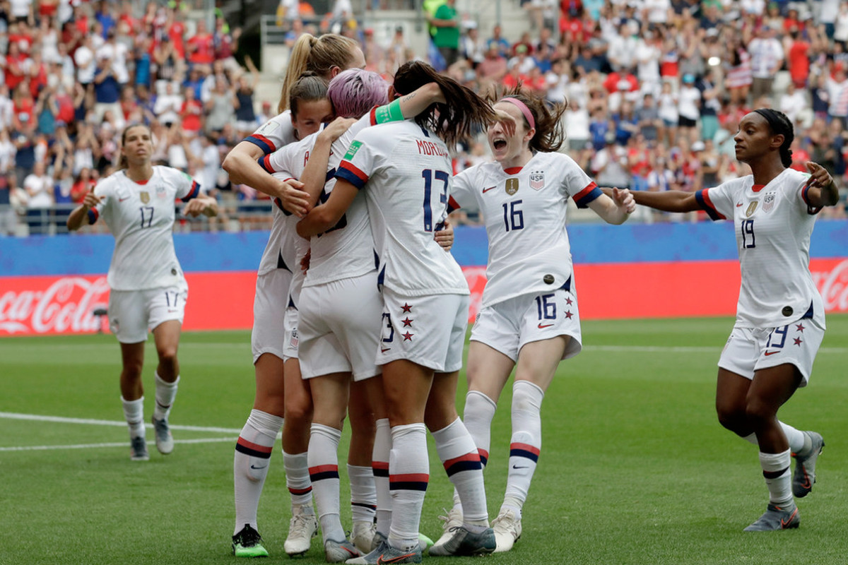 The U.S. women's national team celebrates a goal.