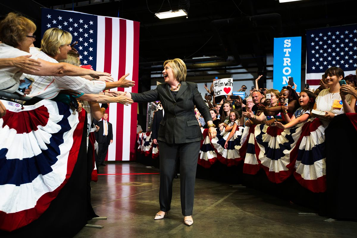 Hillary Clinton reaching out to fans at a rally in Raleigh, North Carolina.