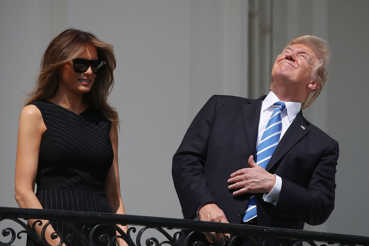 President Trump looks skyward without protective eyewear during the solar eclipse