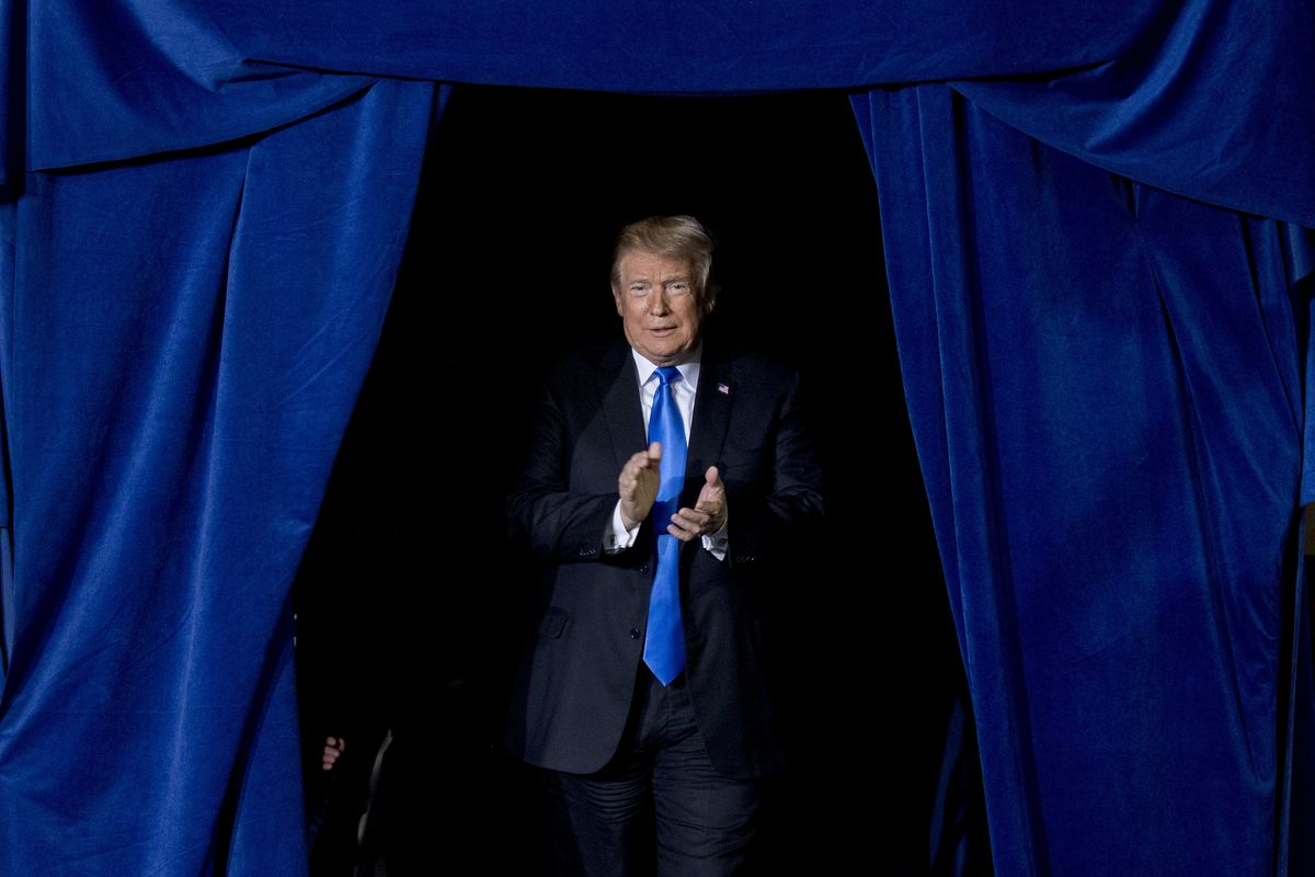 President Donald Trump takes the stage at a rally at Alumni Coliseum in Richmond, Kentucky, Saturday, Oct. 13, 2018.