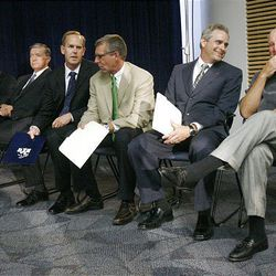 Left to right; Kevin Worthen, Advancement VP at BYU, BYU President Cecil Samuelson, BYU A.D. Tom Holmoe, Dave Brown V.P. of Programming for ESPN, WCC Commissioner Jamie Zaninovich and former BYU football coach LaVell Edwards gather before BYU officials announce going independent in football and joining the WCC for other sports and their contract with ESPN.