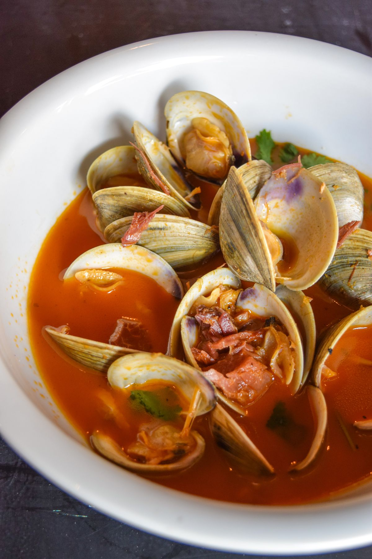 Clams and ham hock in bloody mary broth