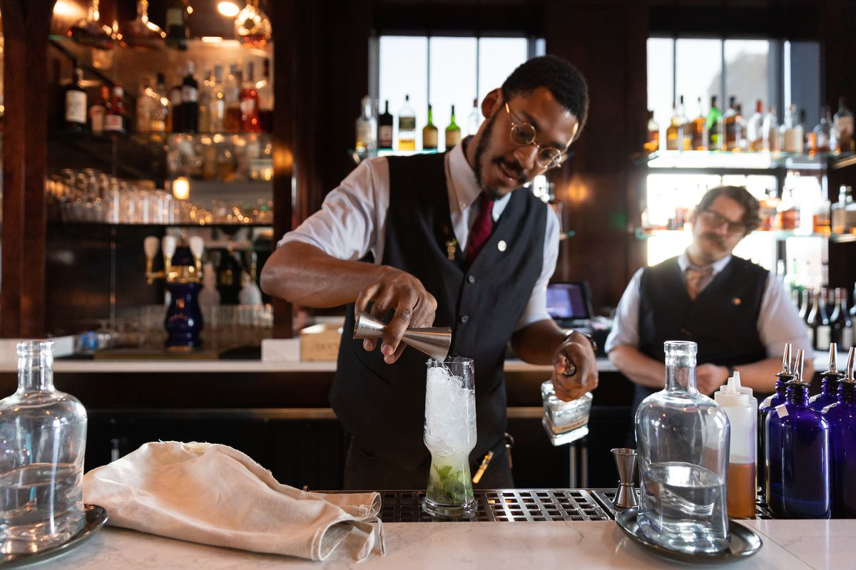 John S. Neely prepares a cocktail at the Monarch Club in Detroit.