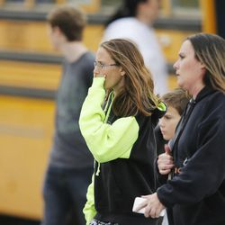 Parents wait for the children as Fremont High School students are evacuated from the school after reports of a student with a gun were made in Ogden Monday, Dec. 1, 2014.