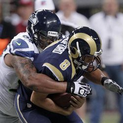 St. Louis Rams quarterback Sam Bradford (8) is sacked by Seattle Seahawks defensive tackle Alan Branch during the first half of an NFL football game Sunday, Sept. 30, 2012, in St. Louis.