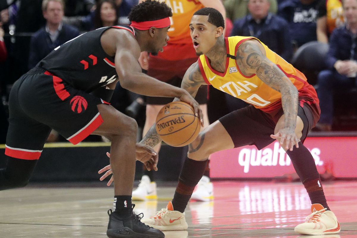 Utah Jazz guard Jordan Clarkson (00) guards Toronto Raptors guard Terence Davis (0) during an NBA game at Vivint Arena in Salt Lake City on Monday, March 9, 2020. The Jazz lost 92-101.
