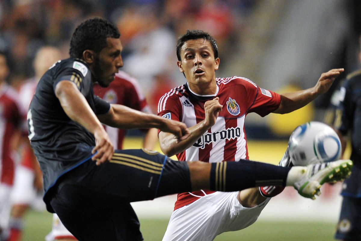 CHESTER, PA- JUNE 25: Marcos Mondaini #23 of Chivas USA and Carlos Valdes #5 of the Philadelphia Union both try to kick the ball at PPL Park on June 25, 2011 in Chester, Pennsylvania. (Photo by Drew Hallowell/Getty Images)