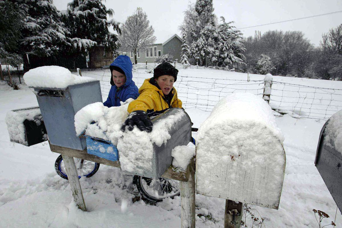 Henry Gards and brother William check the mail box
