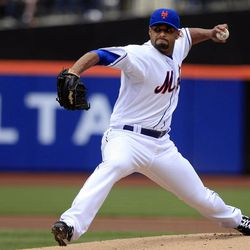 New York Mets' Johan Santana delivers a pitch during the first inning of a baseball game against the Washington Nationals Wednesday, April 11, 2012, in New York.