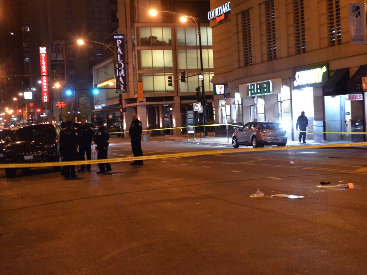 Police investigate a shooting about 5:30 a.m. Saturday, October 27, 2018 in the 0-100 block of West Illinois Street in Chicago. | Justin Jackson/ Sun-Times