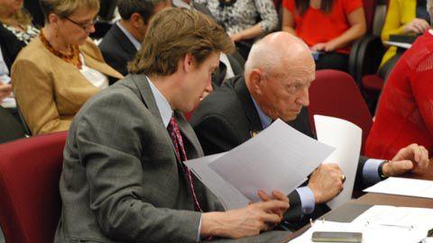 Sens. Mike Johnston and Rollie Heath confer during earlier SB 13-213 committee debate.