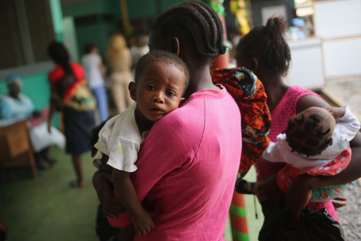 Mothers bring their sick children for treatment at Redemption Hospital in Monrovia. A good vaccine would prevent scenes like these from ever happening again.