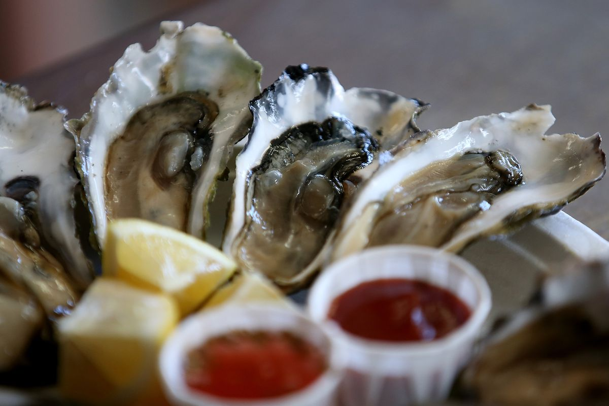 Freshly shucked oysters sit on the counter at Drakes Bay Oyster Co. on the final day of retail and canning operations on July 31, 2014, in Inverness, California.