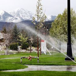 Sprinklers water a lawn in Herriman on Tuesday, April 18, 2017. A local engineering firm has been awarded a $300,000 contract to analyze how the state collects water use data and how that system can be improved.