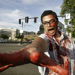 Zombie Walk participant Cameron Powers strolls the streets of Salt Lake City on Sunday.