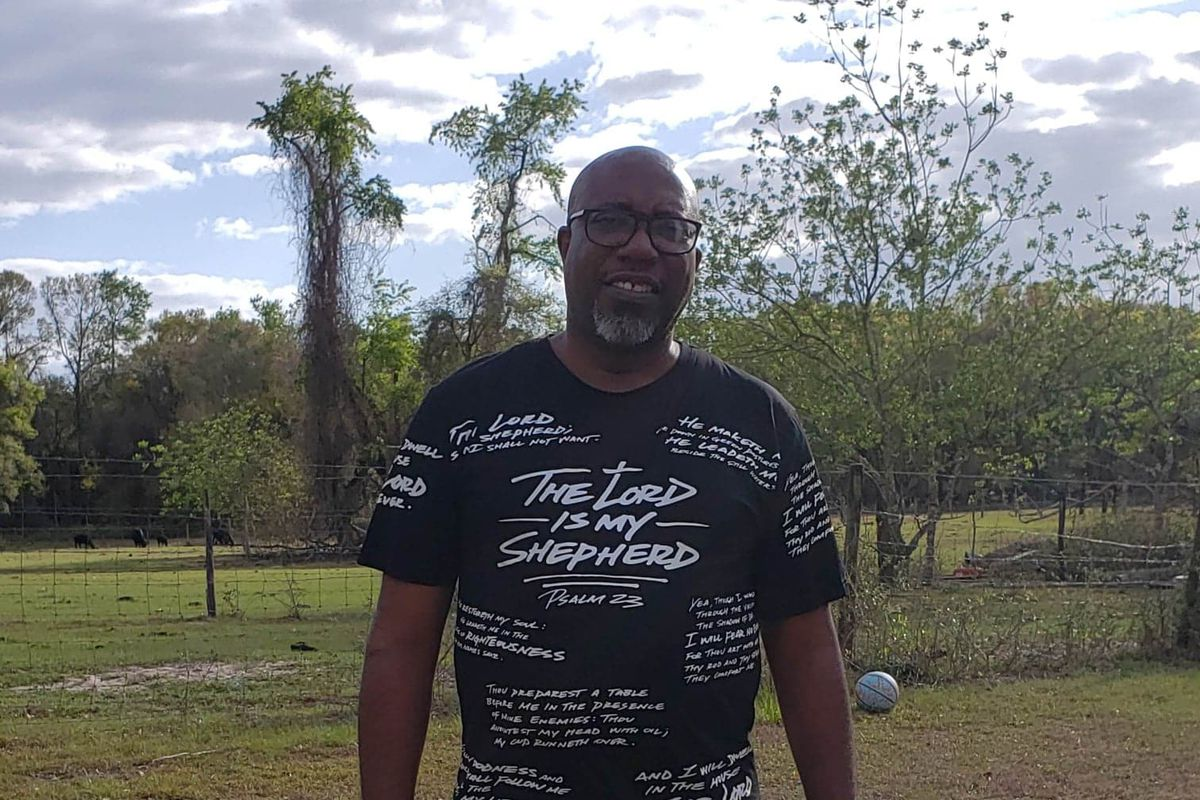 Bishop Chris Stokes poses for a photograph near his north-central Florida home. Stokes is the pastor of New Beginning Christian Worship Center in Micanopy, where he's hosting drive-up church services.