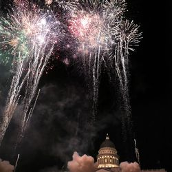 Fireworks fall over the Capitol in celebration of the 125th anniversary of Utah's statehood in Salt Lake City on Monday, Jan. 4, 2021.