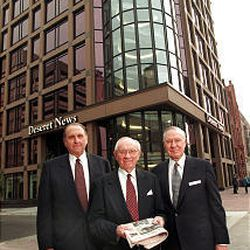 Thomas S. Monson, Gordon B. Hinckley and James Faust in front of the new Deseret News Building May 21, 1997.