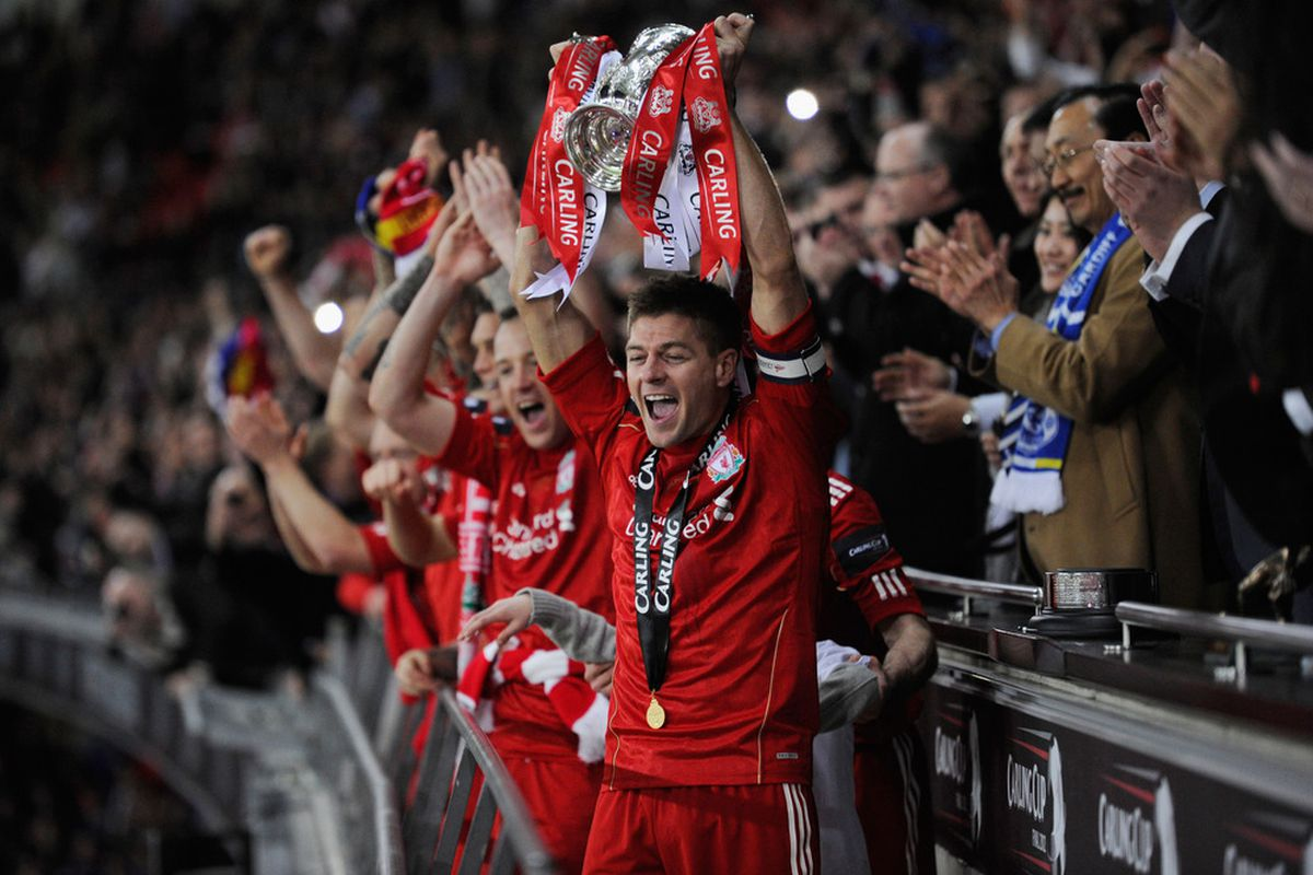 Steven Gerrard of Liverpool lifts the trophy in victory after the Carling Cup Final match between Liverpool and Cardiff City at Wembley Stadium.