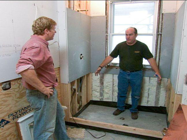 Richard and Kevin measure a tub fitting