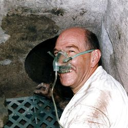 Dale Heaps, an LDS Church conservator, gets ready to reach inside the Salt Lake Temple record stone to retrieve historical items inside on  Aug. 13, 1993.