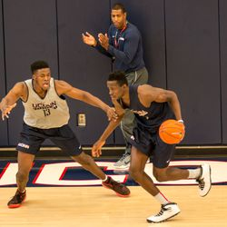 Steven Enoch (13), Amida Brimah (35) and Kevin Ollie