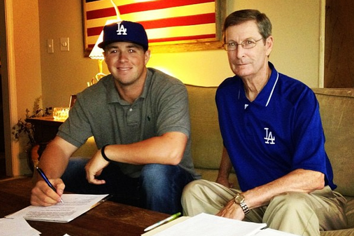 Kyle Farmer signs his first pro contract, with Dodgers scout Lon Joyce.