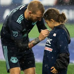 FOXBOROUGH, MA - APRIL 20: New York Red Bulls midfielder Daniel Royer #77 signs a fan's shirt prior to the game at Gillette Stadium on April 20, 2019 in Foxborough, Massachusetts. (Photo by J. Alexander Dolan - The Bent Musket)