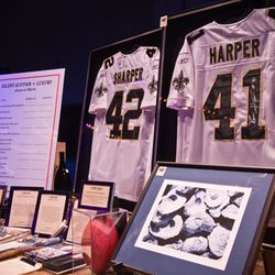 Signed jerseys from Roman Harper and Darren Sharper, auctioned off together as part of the silent auction.
