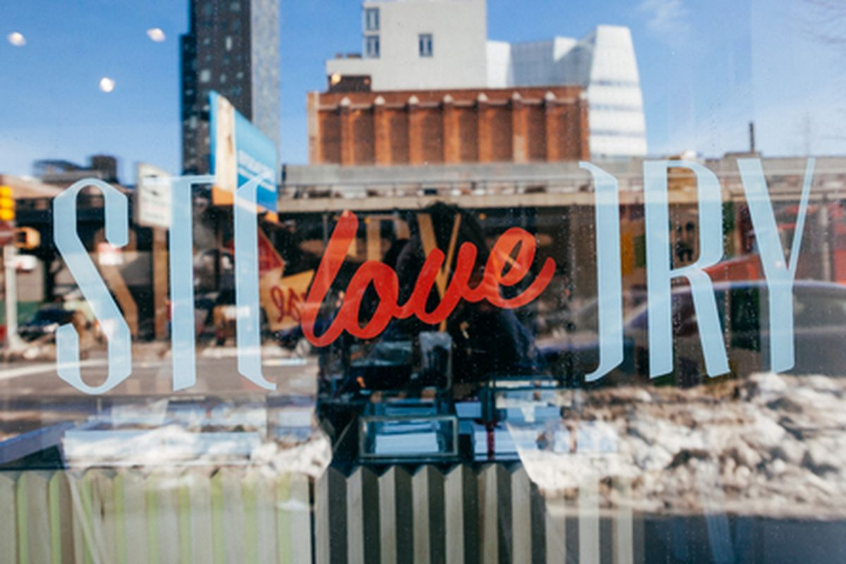 """Signage from one of the shop's recent stories: <a href=""""http://ny.racked.com/archives/2014/02/10/story_in_chelsea_teams_up_with_40_days_of_dating.php"""">Love</a>"""