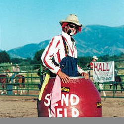 """Beck stands in his barrel at a recent rodeo. He loves to be inside the barrel when bulls are hitting it. """"That's a pretty big rush."""""""