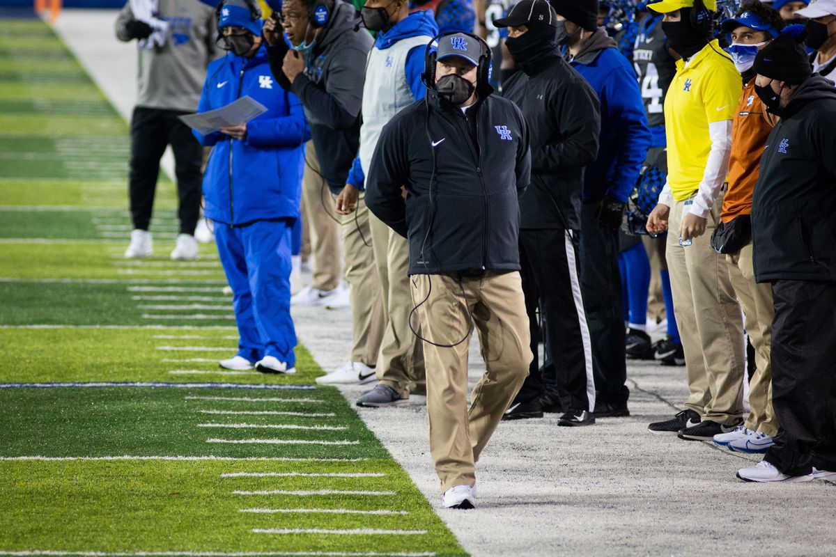 Kentucky Wildcats head coach Mark Stoops coaches from the sidelines during the first quarter against the South Carolina Gamecocks at Kroger Field.