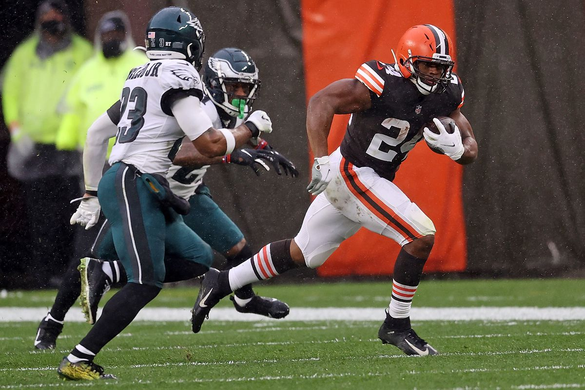 Nick Chubb #24 of the Cleveland Browns is pursued by Rodney McLeod #23 of the Philadelphia Eagles during the first half at FirstEnergy Stadium on November 22, 2020 in Cleveland, Ohio.