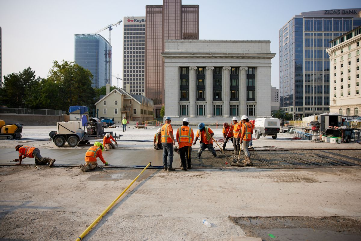 Crews replace delaminated concrete on the Church Office Building Plaza.