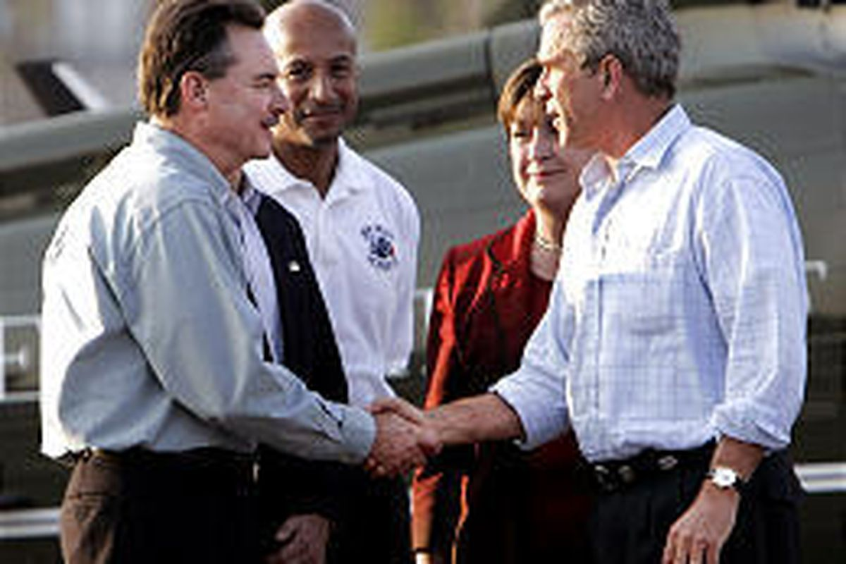 R. David Paulison, acting director of FEMA, left, greets President Bush in New Orleans. With them are New Orleans Mayor Ray Nagin, Louisiana Gov. Kathleen Blanco.